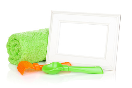 birthday boy: Photo frame with bath towel and toys. Isolated on white background