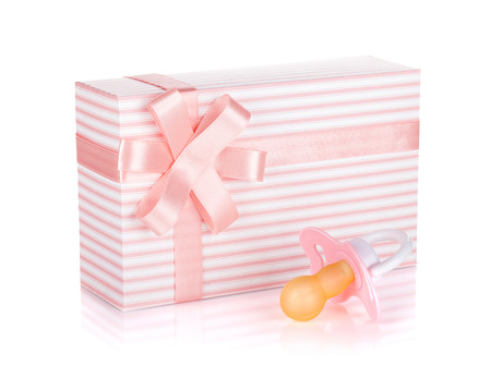 Gift box and pacifier for little girl. Isolated on white background photo