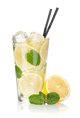 Glass of lemonade with lemon and mint. Isolated on white background photo