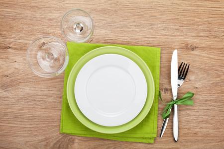 flatware: Kitchen utensils over wooden table with copyspace