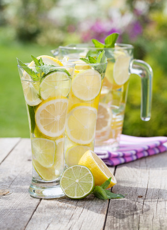 Homemade lemonade with fresh citruses photo