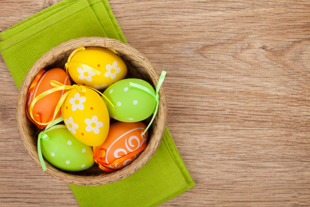 Easter eggs on wooden background with copy space photo