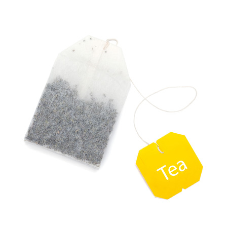 teabag: Teabag with yellow label. Isolated on white background