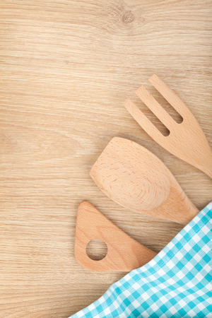 Kitchen utensils on wooden table photo