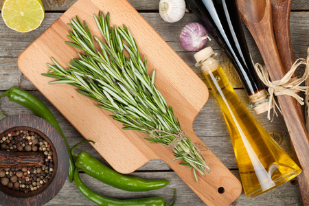 Herbs, spices and seasoning over wooden table background photo