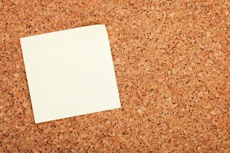 postits: Blank postit note on cork wood notice board with copy space Stock Photo