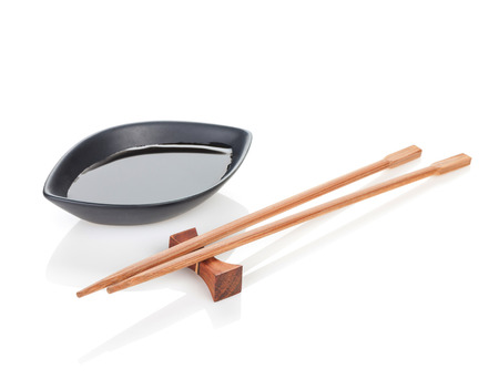 Sushi chopsticks and soy sauce. Isolated on white background photo