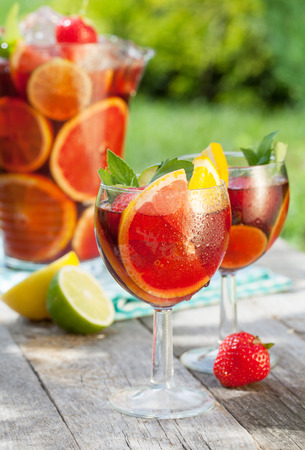 Refreshing fruit sangria (punch) on wood table photo
