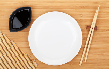 chop stick: Empty plate, sushi chopsticks and soy sauce on bamboo table
