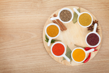 curry powder: Various spices selection on wooden table