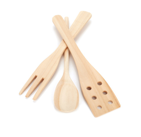 Wooden cooking utensils. Isolated over white background photo