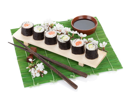 Sushi set with fresh sakura branch. Isolated on white background photo