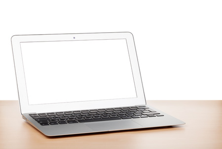 Laptop with blank screen on table. Isolated on white background photo