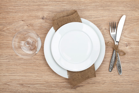 empty plate: Empty plate, wine glass and silverware set on wooden table