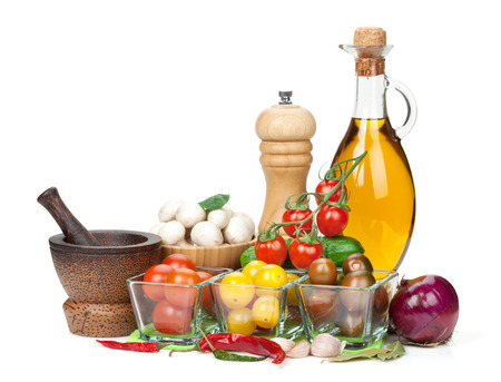Fresh ingredients for cooking: tomato, cucumber, mushroom and spices. Isolated on white background photo
