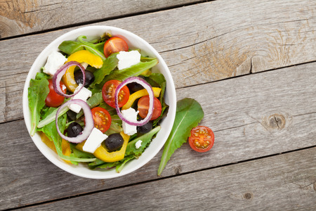 greek cuisine: Fresh healthy salad on wooden table.  Stock Photo