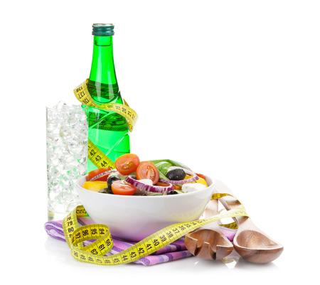 Fresh healthy salad and soda water. photo
