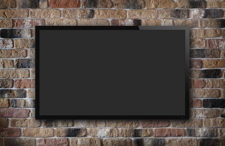 오래 된 벽돌 벽 배경에 TV 디스플레이 스톡 콘텐츠
