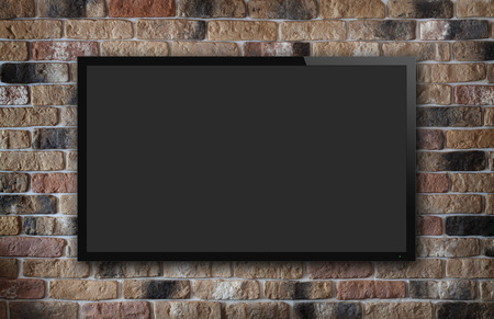 TV display on old brick wall background