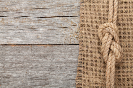 rope knot: Ship rope on old wooden texture background with copy space