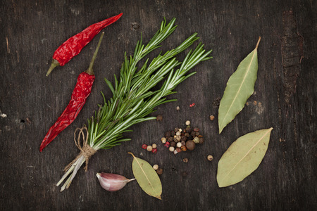 Herbs and spices over old wood table background photo