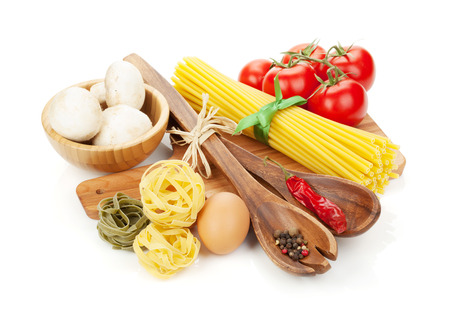 pasta isolated: Pasta and ingredients. Isolated on white background Stock Photo