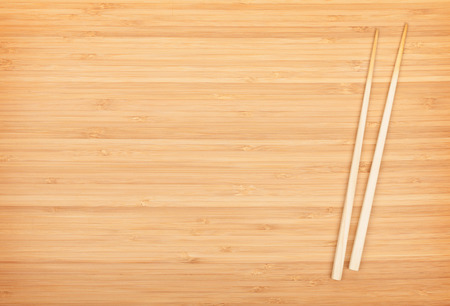 Sushi chopsticks on bamboo table with copy space photo