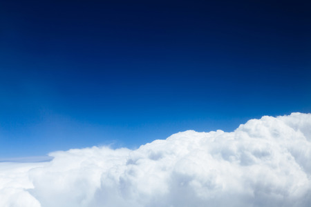 rise to the top: Blue sky with clouds background with copy space. View from airplane