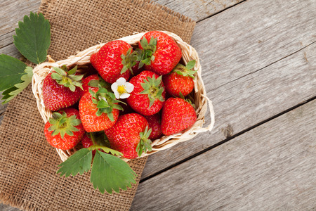 Fresh strawberry in basket on wooden table background with copy space Stock Photo
