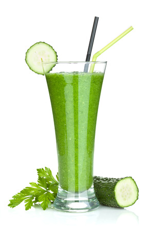 Green vegetable smoothie with cucumber and herbs. Isolated on white background