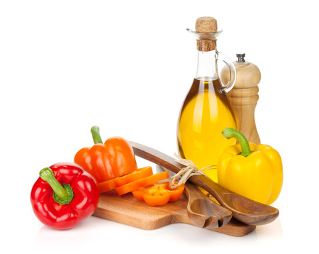Colorful bell peppers and kitchen utensils. Isolated on white background photo