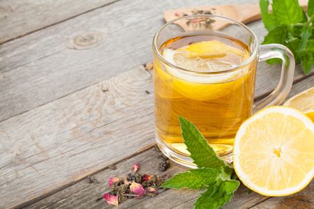 tea crop: Green tea with lemon and mint on wooden table background with copy space