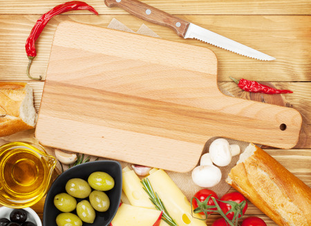 space for copy: Empty cutting board for copy space and various food