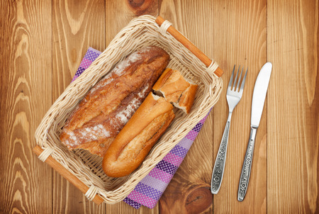 french bread: Homemade french bread over wooden table background Stock Photo