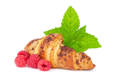 Fresh croissant with berries. Isolated on white background photo