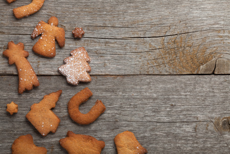 Various gingerbread cookies on wooden table background with copy space photo