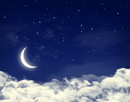 Moon and stars in a cloudy night blue sky background photo
