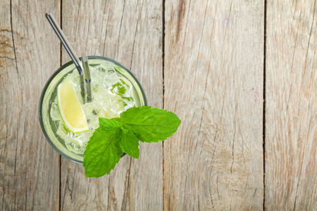 Fresh mojito cocktail on wooden table with copy space Stock Photo