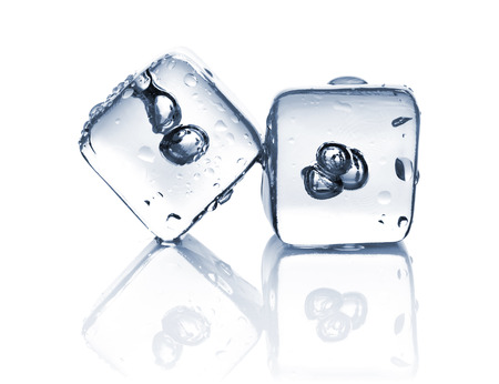 Two melting ice cubes with water dew on white background photo