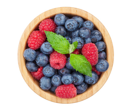 Blueberries and raspberries with mint leaf. Isolated on white background photo