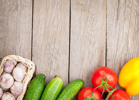 Fresh ripe vegetables on wooden table with copy space Stock Photo