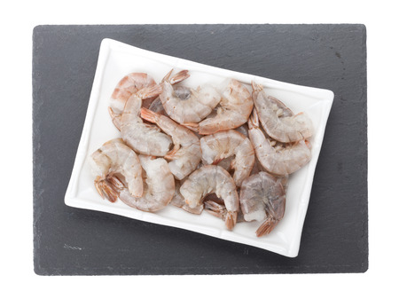 Raw uncooked shrimps plate over stone board. Isolated on white background Stok Fotoğraf