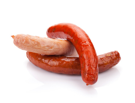 Various grilled sausages. Isolated on white background photo