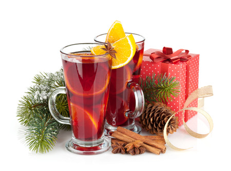 Christmas mulled wine with spices, gift box and snowy fir tree. Isolated on white background photo