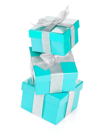three gift boxes: Three blue gift boxes with silver ribbon and bow. Isolated on white background