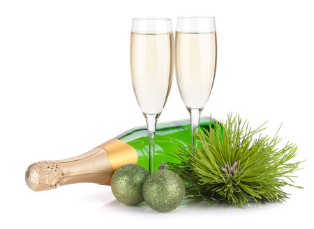 Champagne, firtree and christmas decor. Isolated on white background photo