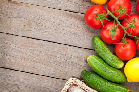 Fresh ripe vegetables on wooden table with copy space photo