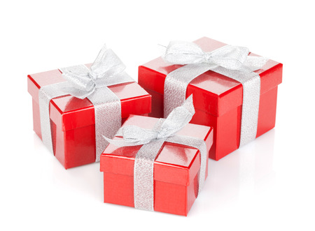 three gift boxes: Three red gift boxes with silver ribbon and bow. Isolated on white background Stock Photo