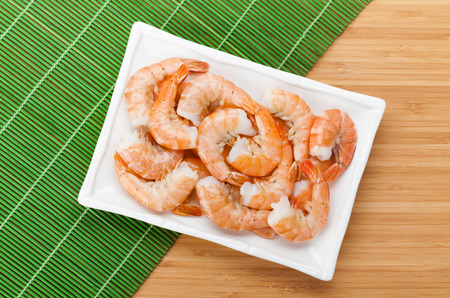 tiger shrimp: Cooked shrimps. View from above on wooden table