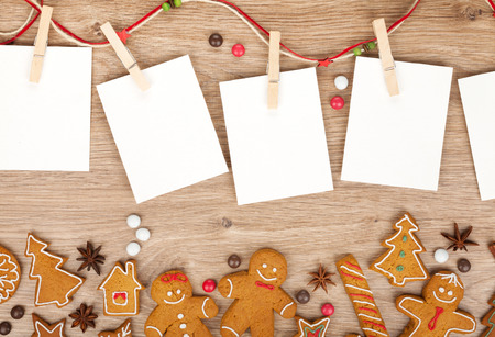 Blank christmas photo frames with homemade gingerbread cookies